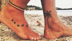 Tatuaggio sulla spiaggia, rischio cicatrici permanenti
